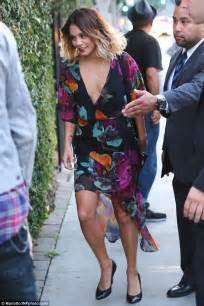 Vanessa Hudgens shows cleavage as she and boyfriend Austin